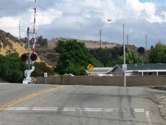 As seen at this location in Moorpark, vehicle skid marks, worn safety markings and minimum standard safety devices are hallmarks of most grade crossings in Ventura County, California - Click for larger image (http://jamesmcgillis.com)